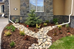 Dry Stream Rock Bed from Drainspout and Mulch Bed with Various plants
