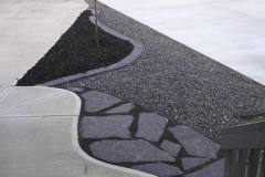 Borders - charcoal cobble mow brick with 20 mm rundle, black mulch and rundle flagstone pathway