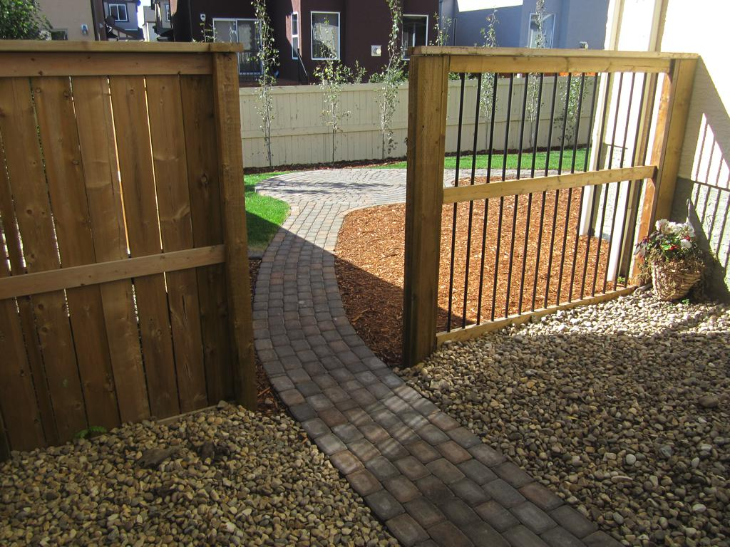 Fences - pressure treated fence with 6 inch aluminum spindle decorative fence