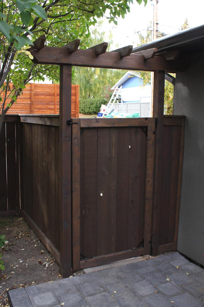 Fences - stained friendly neighbour fence and gate with decorative arbor
