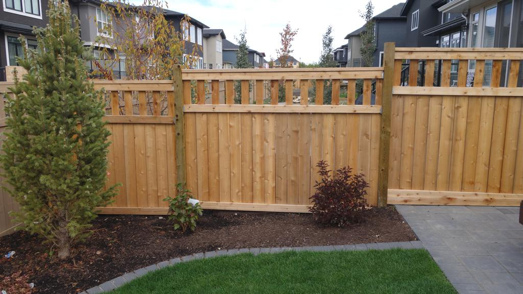 Fences - tiered pressure treated fence with custom slat top