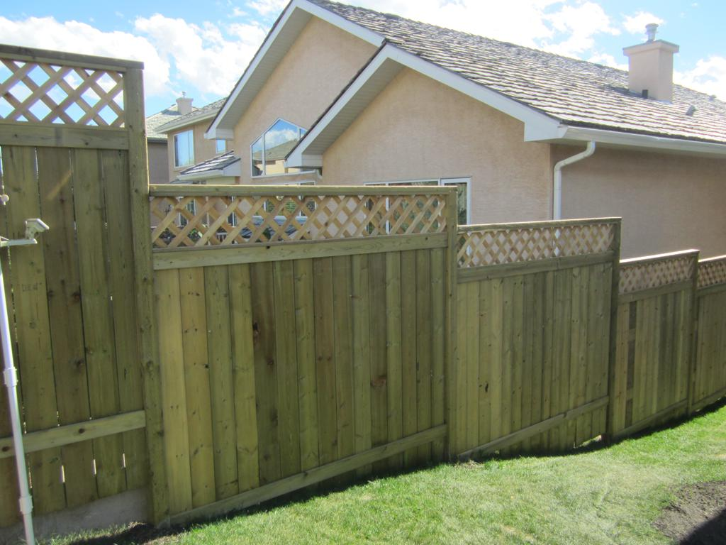Fences - tiered pressure treated lattice topped estate style fence