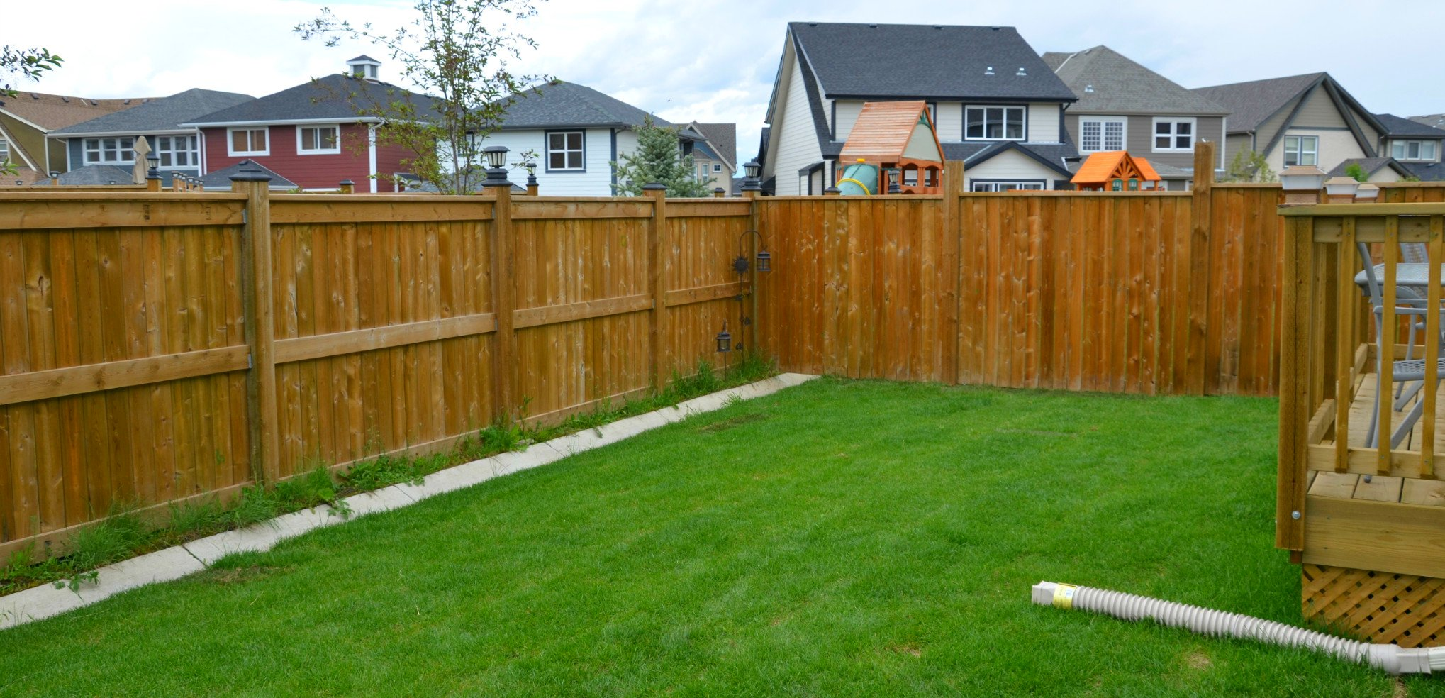 fences - pressure treated fortress style fence with post caps