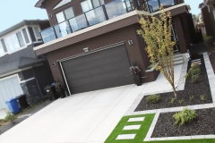 front yard curb appeal with artificial turf, mow brick borers and black mulch plant beds