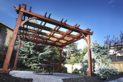 stained cedar pergola with decorative double beams