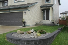 retaining wall - charcoal pisa II retaining wall revers a cap coping and 28 mm washed gravel bed