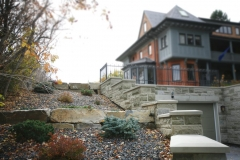 retaining wall - ironstone tiered retaining wall with mulch beds and pernenials