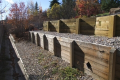 retaining wall - pressure treated tiered wall